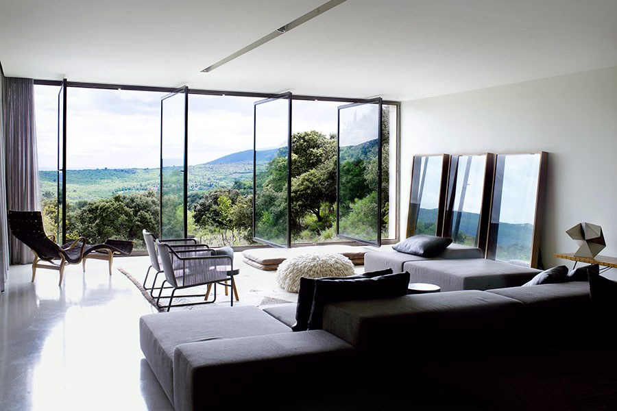 contemporary interior design sample showing sofa chair and windows outlook